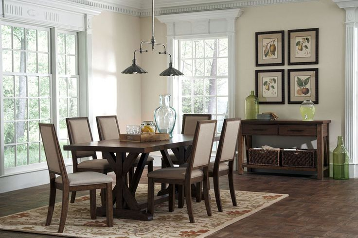 BRIDGEPORT COLLECTION   	Wire brushed wood finish with a coat of dust wax  	Fixed top tables with stout craftsman style bases  	Wood framed upholstered chairs with nailhead trimming  	Linen tone fabric upholstered chairs have small metal nail tacks for a refined rustic feel     dining sets