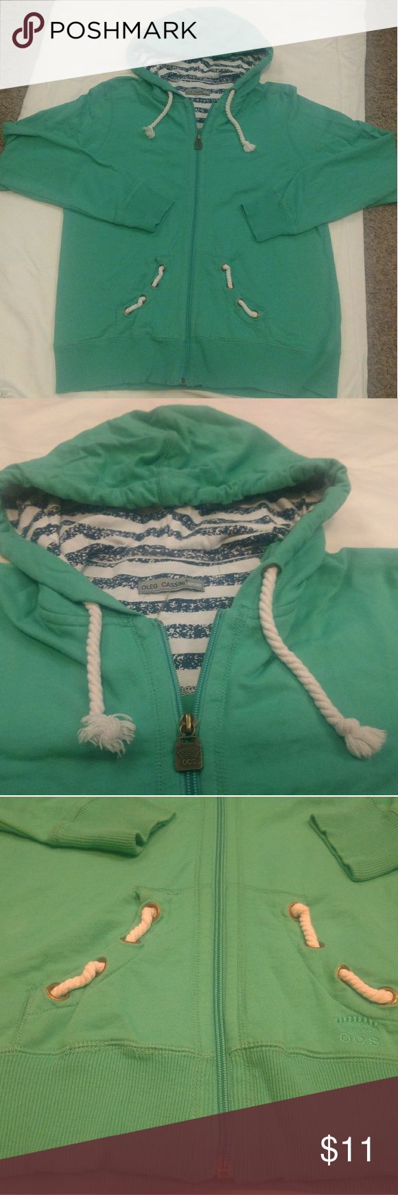 Women's green zip up hoodie Oleg Cassini sport Nice hoodie! Zips up front with cute rope ties. Soft green with white & navy striped inside some parts/ accent print. Smoke and pet free home. Oleg Cassini Sport Tops Sweatshirts & Hoodies