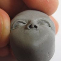 how to sculpt a face in clay - every step, this pin is in the middle of the web site. The artist is Amanda Day