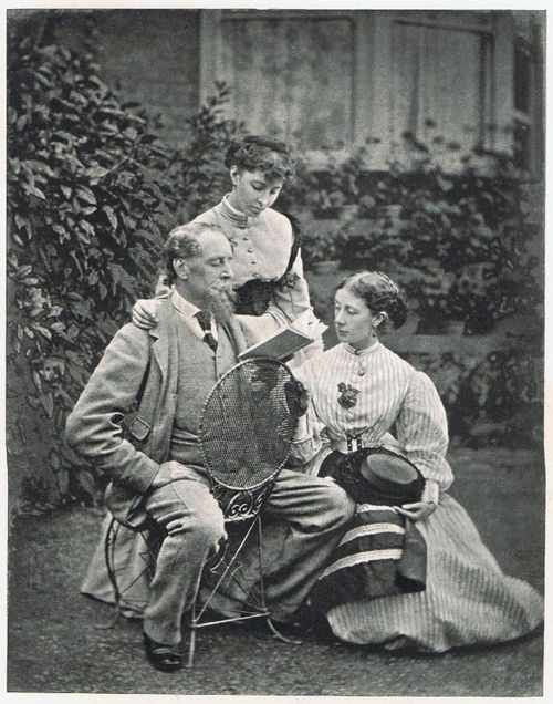 Charles Dickens reads to his daughters.