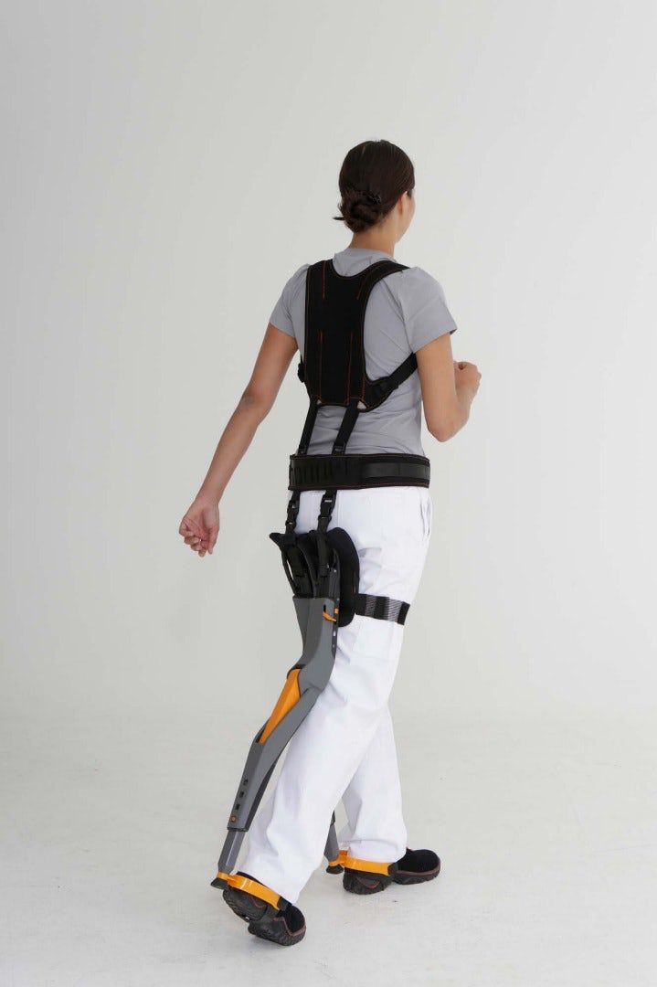 Audi Testing Carbon Fiber Exoskeleton Chairless Chair For Assembly Workers Wearable Technology Wearable Robots Exoskeleton Suit