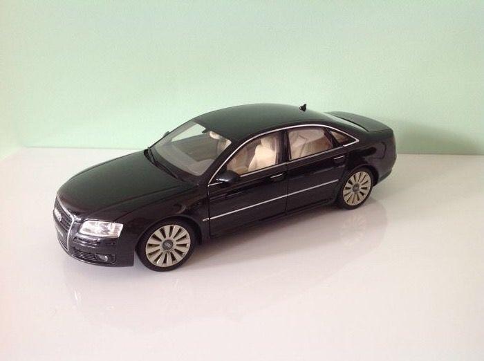 Kyosho - Schaal 1/18 - AudiA8 W12 'Bang & Olufsen' uitvoering - Phantom Black  Zeldzame Audi A8 W12 van het merk Kyosho verzamel object. De Audi is uitgegeven met Bang & Olufsen kentekenplaat ter introductie van de eerste B&O audio installatie in deze prachtwagen. Het betreft een schaalmodel met de schaal 1/18. De kleur is Phantom black en het is een zeer mooi exemplaar waar de details van het interieur goed zichtbaar en afgewerkt zijn. Alle deuren kunnen open en tevens de motorklep en de…