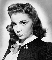 Joan Leslie, petite redhaired film and TV actress, extremely popular in the 40s/50s. Was in 40+ films, mostly wholesome girl-next-door, as the leading man's sweetheart opposite big names: Astaire, Bogart, Cooper and Cagney. Married Dr. William Caldwell in 1950 & retired to raise her twin daughters. Was only thereafter in TV commercials and occasional guest appearances in shows as 'Murder, She Wrote' and 'Charlie's Angels'. Gave much time to humanitarian work and a new career as a dress…