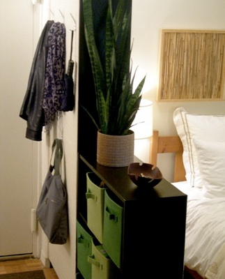 Create a separate entryway and bedroom area in a studio apartment using plain BILLY bookcases from Ikea, natural jute grasscloth and working with only basic tools - no workshop required. If you're a renter, it's an easy and budget-friendly way to customize your space. And you can take your DIY room divider with you when you move out!