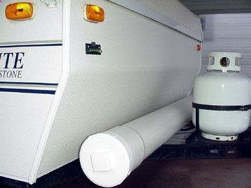 Camping DIY: Pop-up camper mod. 6 PVC pipe mounted on camper to hold outdoor carpet. It is connected to the frame with internal stainless steel carriage bolts and hardware. A cap on the left and screw plug on the right should keep the carpet nice and dry. Genius!