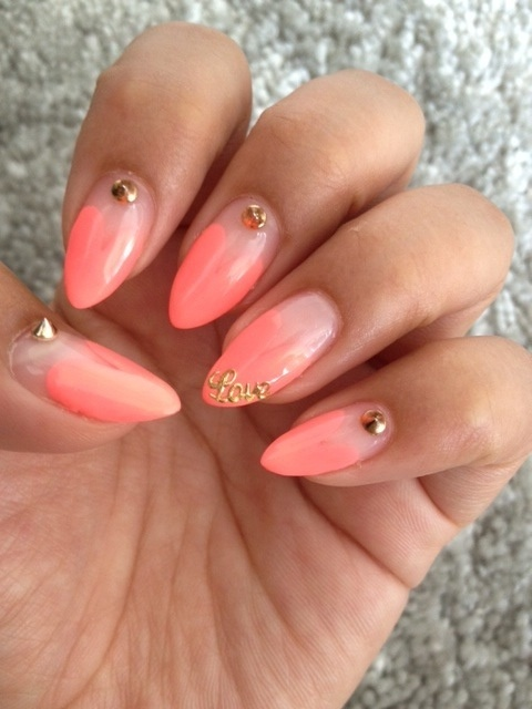 coral ombre nails with gold embellishment
