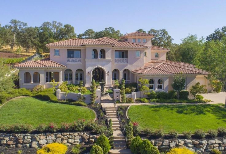 This Mediterranean style home is located at 26 Powers Drive in a gated community in El Dorado Hills, California and is situated on 3/4 of an acre of land.