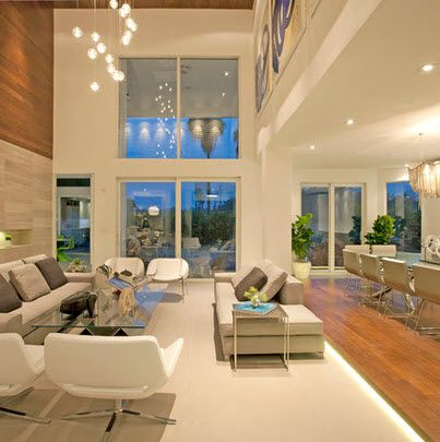 Sala a a doble altura con mueble blancos