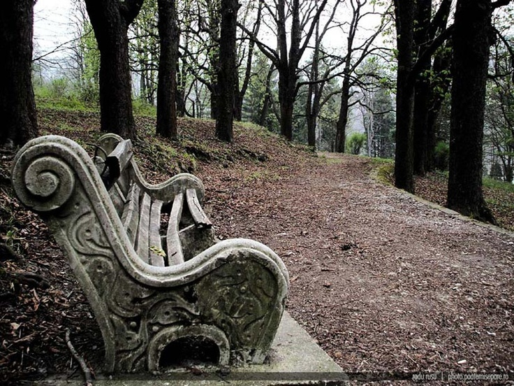 Old bench in a park in Resita, Romania