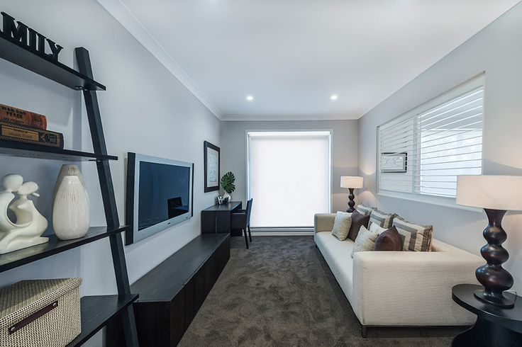 #Living-room #interior #design #inspiration from #Ausbuild's Bellfield display home. This #living-room features soft #espresso carpet combined with a signature white lounge and #earthy #furnishings. The bright #lamp #shades are complimented by the #deep #hues of the #wooden frames.