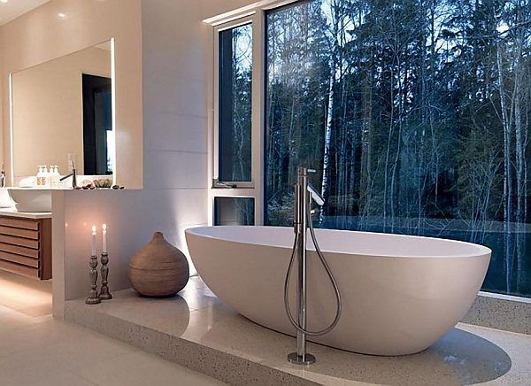 earth toned bathroom with forest views