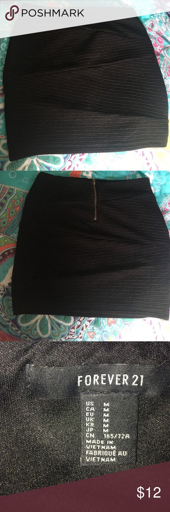Forever 21 tight black skirt Selling a forever 21 fitted black skirt in size M! Never worn (too big on me). Forever 21 Skirts Mini