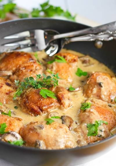 Creamy Chicken and Mushroom Skillet  Ingredients: 8 boneless skinless chicken thighs ½ cup flour seasoned with salt and pepper 2 tablespoons butter 2 tablespoons olive oil 1 pound sliced mushrooms (I used cremini but any will do) 1 large clove garlic, chopped 1½ cups white wine or chicken broth (I used wine...of course!) 1 heaping tablespoon chopped fresh thyme (or 2 teaspoons dry) ½ cup Asiago cheese (or other hard cheese like Parmesean) 2 tablespoons Dijon mustard ½ cup cream