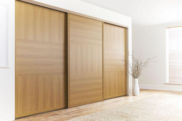 Lissa Oak Doors in Medium Oak Ridged Frame. Design your own Sliding Wardrobe Doors here: http://www.diyhomefit.co.uk/bedrooms/sliding-wardrobe-doors-designer.html