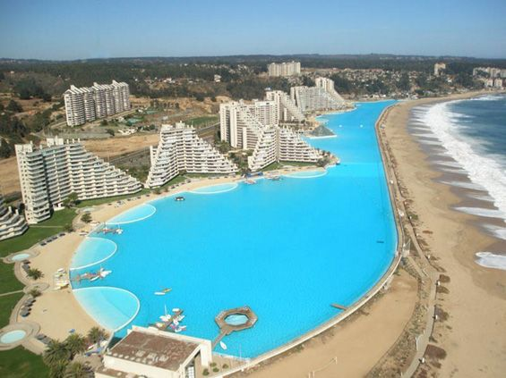 The swimming pool at the resort San Alfonso del Mar in the Chilean city Algarobo, contains 250 million liters of clean seawater, which holds the record for the largest swimming pool in the world. Crystal Lagoon in Chile is large enough for sailing, and has its own artificial beach.