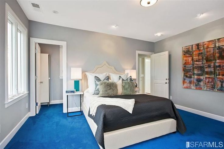 Bedroom with gray whiles and bright blue carpet