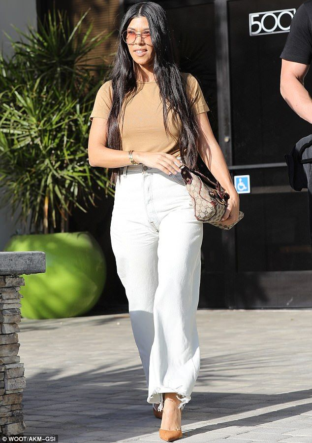 The mother of all looks: Kourtney Kardashian wore baggy mom jeans in LA on Wednesday...