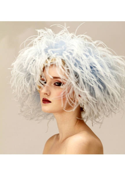 Pump Up the Volume Having a bad hair day on the 29th? Judy Bentincks marabou topper does double duty as a statement hat and wig. Also, in case the bride forgets her something blue, you can save the day! Paule Blue Ostrich Headband, by Judy Bentinck Millinery. For more information visit judybentinck.com.