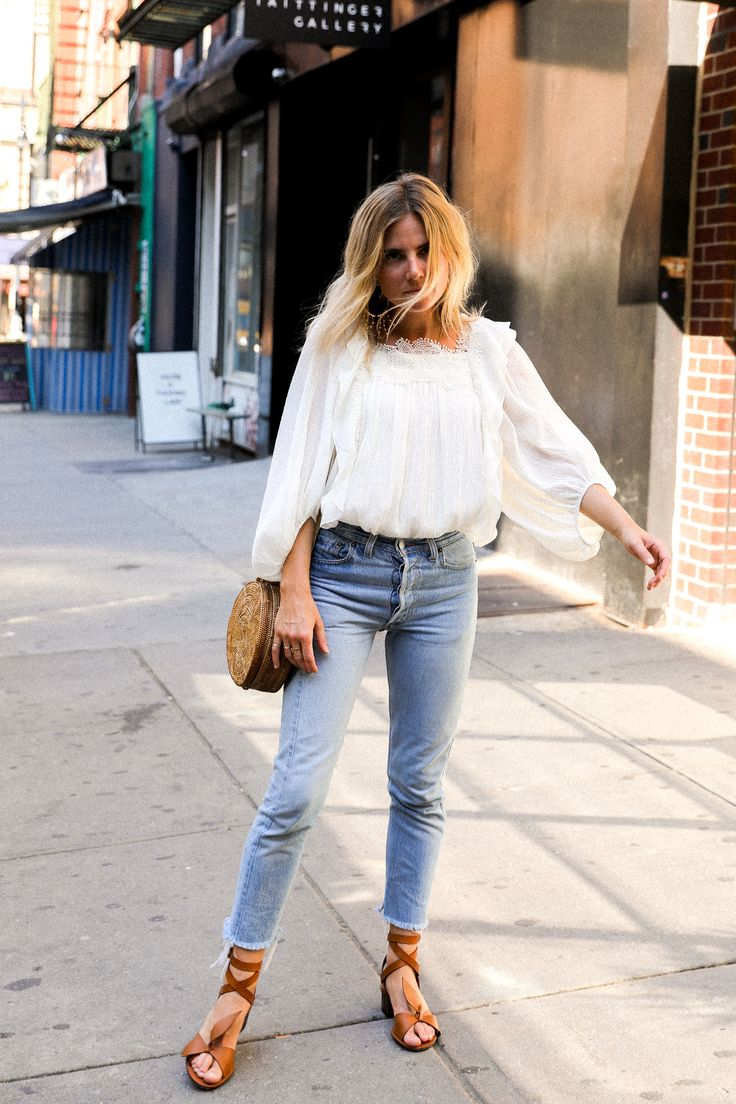 Romantic top, jeans, brown leather sandals.