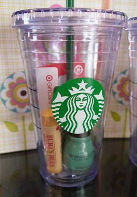 A Starbucks cup filled with a Starbucks gift card, Target gift card, fun nail po…