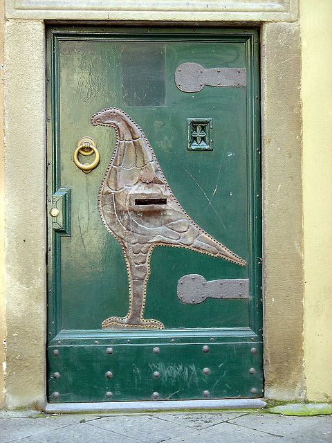 Door with the tin bird, Lucca, Italy