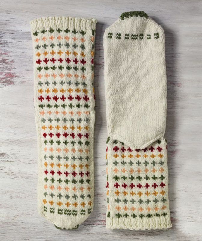 These Colored Cross Socks were inspired by a pair Mimi Seyferth found in a gift shop in Albania. Learn more about the originals and the modern adapted knitting pattern on the blog!