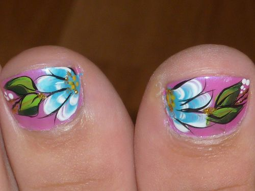 Pretty Painted Toenails...    Give the girl a coupon for a free toenail painting session by none other than YOU! She will love you forever.