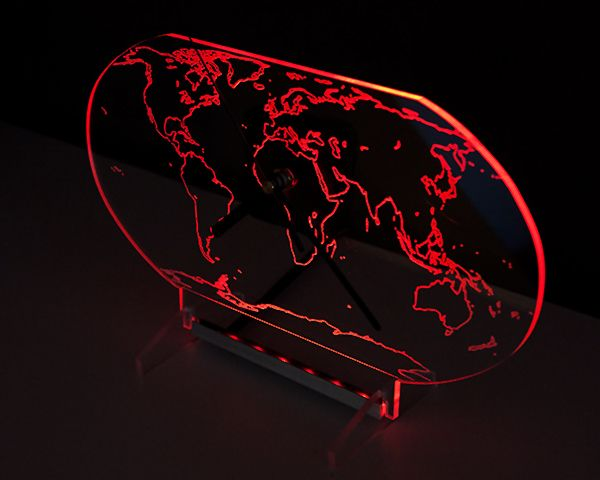 Clock with red backlight LED in the shape of the globe. New design.