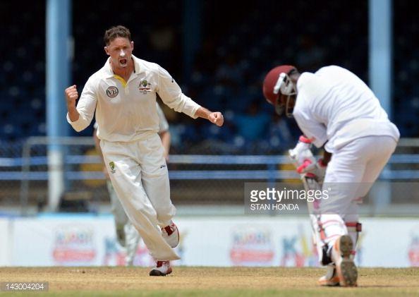 News Photo : Australian bowler Michael Hussey celebrates the...