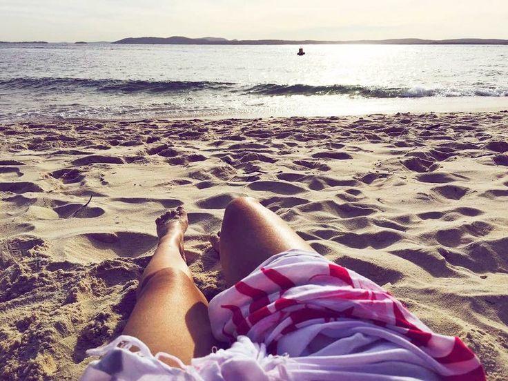 Beach shadow photo shoot silhouette tanning sarong legs sand