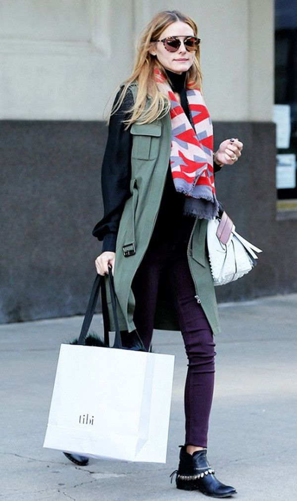 Olivia Palermo wears the perfect fall layered look with skinny jeans and ankle boots.