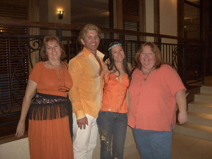 This was at an RT Booklover's Convention for 60's night. We seriously did NOT plan to all wear orange, and it was just too funny not to capture! From left: my Mom, Christine Ritter, CJ Hollenbach, me, and Kelly Salkin