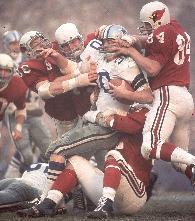 Dallas running back Dan Reeves is gang-tackled by Joe Robb (No. 84), Chuck Walker (No. 79) and Don Brumm (No. 86) during a 1966 game between the Cowboys and Cardinals (Neil Leifer/SI) #EasyPin