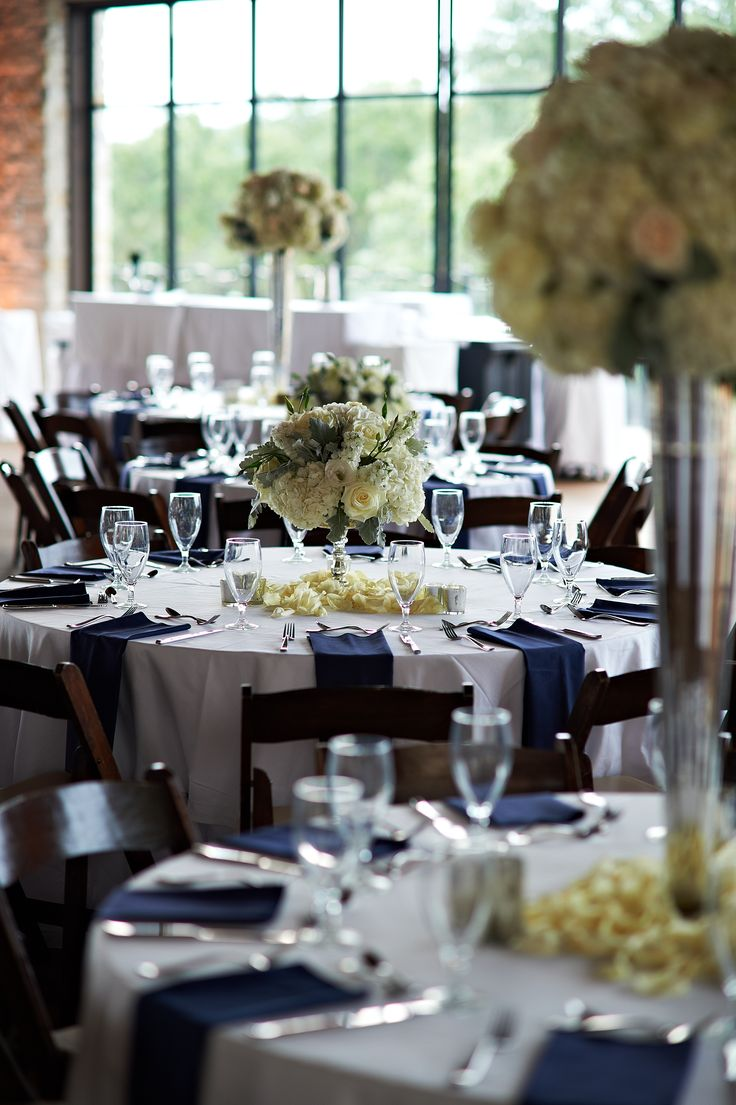 Reception Table Decor | White Rose and Hydrangea Centerpieces | White Table Linens | Navy napkins | Premiere Party Central | Omni Barton Creek Resort and Spa | Bouquets of Austin | Fernando Weberich Photography | Pearl Events Austin