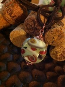 Pendant with copper and goldstone accents on suede cord