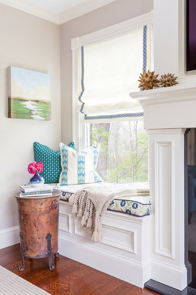 Inviting Window Seat With Blue And White Throw Pillows