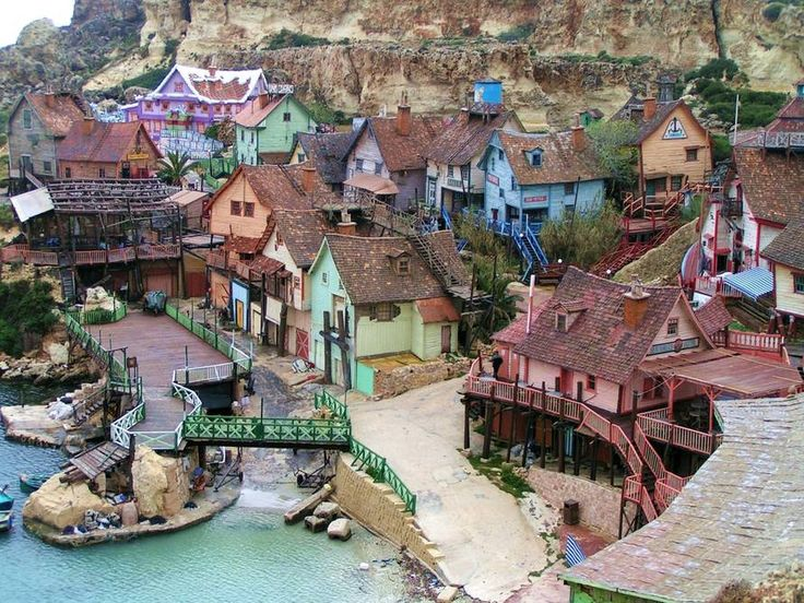 A place where reality and fantasy blends is the village of Sviteven, also known as Popeye Village, in Malta. With colorful houses looking like they were pulled out of a children's book, the 1980s Popeye movie set is now a tourist attraction where visitors can enter buildings and interact with famous characters from the show. #color #travel #world #exterior #malta #popeye #popeyevillage