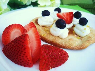Vegan Lemon Coconut Cream with Strawberries and Blueberries on top of Ines Rosales Cinnamon Torta