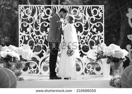 Black and white picture of happy wedding couple together. Groom and bride. - stock photo