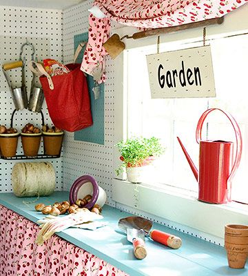 Helpful Work Space          Fun cherry-pattern curtain panels are mounted under a shelf-turned-work-counter to hide rolling bins filled with potting soil and soil amendments. The deep windowsill doubles as a shelf for pots, plants, and watering cans