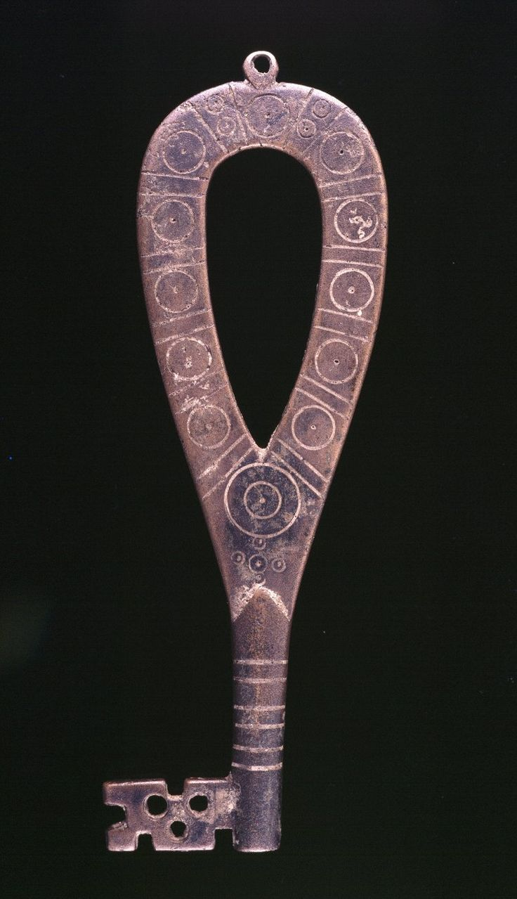 Viking Key; bronze; loop for suspension at head of bow, which is decorated with pattern of circles and lines.