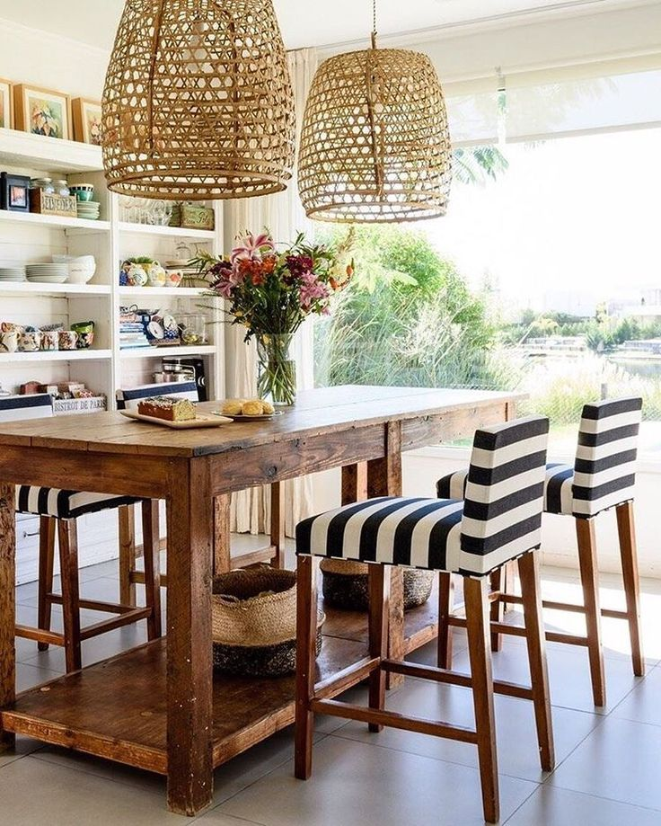 Bright coastal dining space with striped high