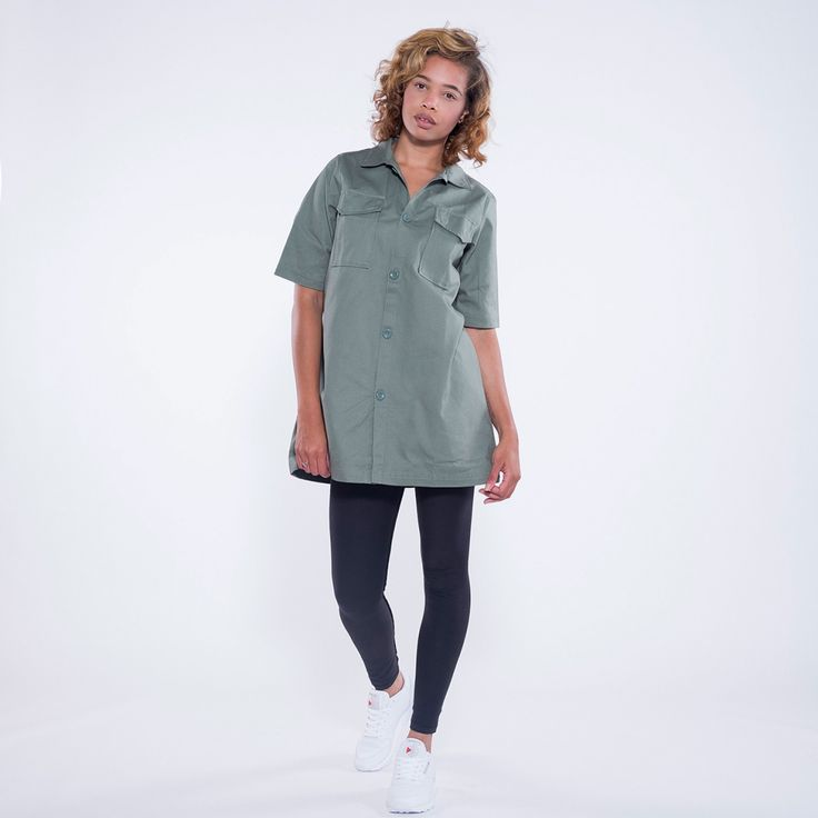 A collab between Reebok and Melody Ehsani in this Military Shirt. Featuring nefertiti print on back, Pockets at chest, Relaxed fit. 100% Cotton.