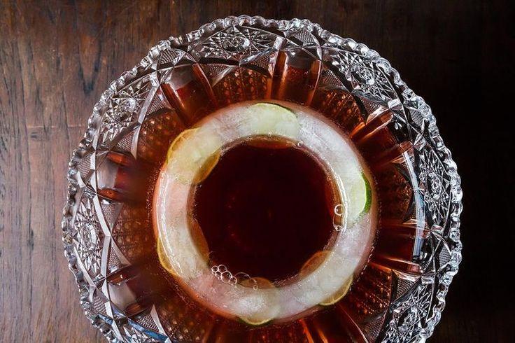 Crimson Bulleit Punch: 2 parts Bulleit bourbon 2 parts cranberry pomegranate juice 1/2 part Domaine de Canton ginger liquer 2 parts Champagne Lime slices
