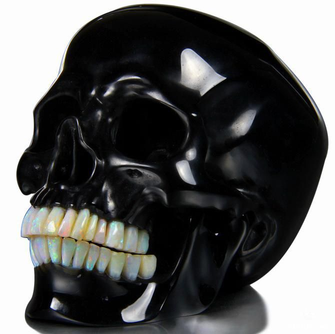 "Stunning work. (via 5.3"" Black Obsidian Carved Crystal Detachable Skull, Opal teeth by Skullis TM)"