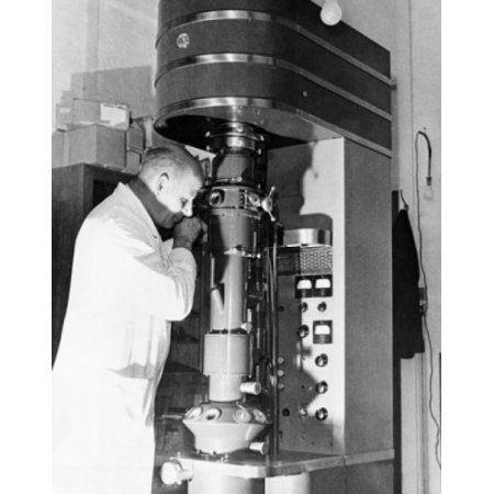 Scientist using an electron microscope in a laboratory Cavendish Laboratory Cambridge University Cambridge England Canvas Art - (24 x 36)