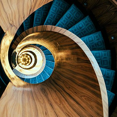Spiral rosewood staircase at luxurious Las Alcobas Hotel, Mexico City