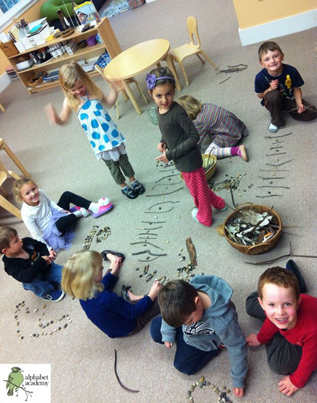 This group activity was about using natural materials (pebbles, sticks, twigs and rocks) to make a collaborative pattern. Friends worked to make patterns in many different ways and connected them together! — Alphabet Academy North Kindergarten http://thealphabetacademy.com #reggio-inspired #nature #collaboration #groups #sticks #stones #kindergarten