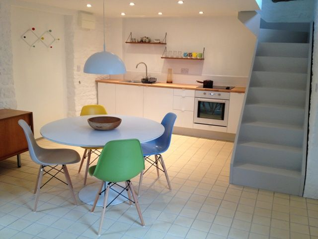 Open plan kitchen and dining room, painted starrcase