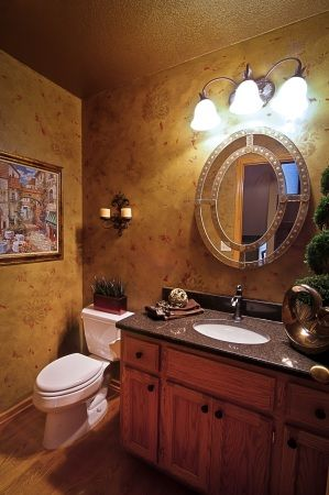 Classic Bathroom Remodel With Granite Counters, Tan Painted Walls, Light  Wood Cabinets And Of Course, Over Vanity Lighting. See Some Of Our Remodeling  Tips.